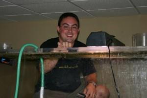 Steven standing inside a 500 gallon tank